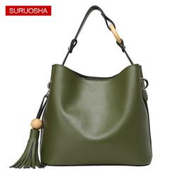 Bands Handbags Australia - SURUOSHA Green Bucket Bag Ladies Luxury Shoulder Bag Wooden Decoration Tassel Women Bags Luxury Band Designer Handbag Fashion