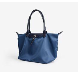 $enCountryForm.capitalKeyWord NZ - Female handbag new Oxford cloth waterproof nylon multi-function folding fashion Mummy bag portable dumpling type bag free shipping