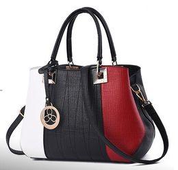 $enCountryForm.capitalKeyWord Australia - New style fashionable lady hand bag match color handbag Europe women's bag leisure single shoulder bag