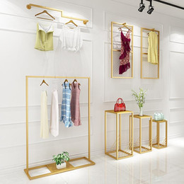 Golden iron clothing rack modern simple floor hanger clothing store clothing rack wall hanger women's Vintage floor type clothes rack on Sale