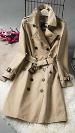 Wholesale long cotton trench coat women for sale - Group buy Women s windbreaker long double breasted trench coats belt slim solid color windbreaker waterproof British classic classic trench coats