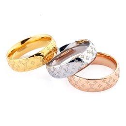 Ingrosso Classic Logo Design Pattern Coppia anello caldo di modo europeo Vendita di gioielli di design di qualità di titanio ad alta Wedding Ring Unisex