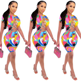 ladies sexy halter summer jumpsuits Canada - Summer Hottest Multcolored Printing Jumpsuits for Women Sexy Lady Halter Neck Sleeveless Lace up Hollow Out Skinny Playsuits Ladies 2020