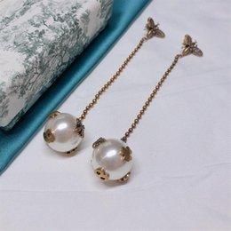 $enCountryForm.capitalKeyWord Australia - New brand new women's brand bee long pearl ball earrings fashion classic earrings, personality sexy earrings, brass material