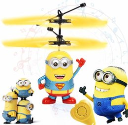 Toy Flying Helicopters NZ - Minion drone RC Helicopter Aircraft Mini drone Fly Flashing helicopter Hand Control RC Toys Minion Quadcopter Dron LED Kids Toys