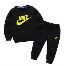 Kids Oxford Girls UK - HOT Brand NIKE New Style Children's Clothing For Boys And Girls Sports Suit Baby Infant Short Sleeve Clothes Kids classic Set 2-7 Age