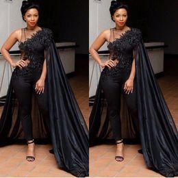 db18275e0cc5 Sexy Black Illusion Jumpsuits Evening Dresses With Cape Wrap Plus Size  South Africa Lace Applique Prom Dresses Women Formal Party Wear