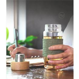 Vente en gros Bouteille d'eau en verre de style européen 400ML avec le bureau de voiture de voyage résistant à la chaleur de tamis d'infuseur de thé Bouteilles de thé