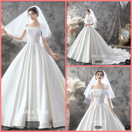 $enCountryForm.capitalKeyWord Australia - Robe de Mariage 2019 new designer white satin ball gown wedding dress off the shoulder short sleeve princess puffy long bride gowns hot sale