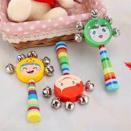 Discount bell shakers - Wooden Cartoon Smiling Face Rattle Rainbow Color Hand Bell Baby Rattles Jingle Bells Infant Shaker Rattle Education Musi