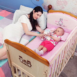 Solid Baby Bedding Australia - Crib solid wood without paint safety children's bed stitching bed multi-functional baby with roller mosquito net