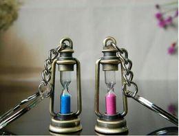 $enCountryForm.capitalKeyWord NZ - 2019 Cute Metal Lamp Shape Timer Hourglass Key Chain Ring Couple Keychain Creative Trinket Novelty Item Best Gift for Women&men