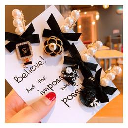 Discount fresh pearls wholesale - Korea simple fresh retro wind girl heart camellia pearl hairpin headdress bangs clip word clip jewelry VIP counter gift