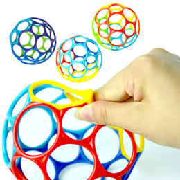 Discount kids toy ball rattle - Large Fun Rattles Develop Baby Intelligence Grasping Gums Wave Ball Hand Bell Funny Bite Catch Hole Toys Xmas Kids Birth