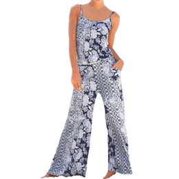 Discount ladies holiday clothing - Sexy Womens Jumpsuit Lady Strappy Floral Strap Long Loose Playsuits Jumpsuit Women Rompers Holiday Clothes Summer Beach