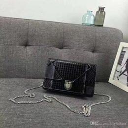 $enCountryForm.capitalKeyWord Australia - WOC Ama chain Big Tenge Bag classic series Lady Evening bags Cowhide Genuine Leather Solid Simple fashion hand Mini bag 19CM