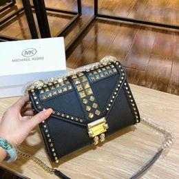 Nail New cartooN online shopping - Ladies bag new trend gold metal nail decoration Joker shopping bag Large capacity practical ladies handbag size24 cmw98