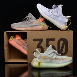 Top V2 zapatos de diseño para hombre Zapatos estáticos para correr Hombres Mujeres Azul Tinte Negro Blanco Kanye West Sport Zapatillas deportivas con caja Eur 36-48