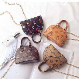 Korean mini Kids handbags online shopping - Kids Handbags Korean Fashion print Designer baby Purse Teenager Girls Mini Messenger Bags Children PU Shell Shoulder Bags C5601