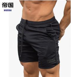 231a782ebe Pantalones cortos deportivos de verano Hombres Fitness pantalones de  chándal de crossfit Pantalones cortos de compresión Ropa interior Hombres  Gym Cotton ...