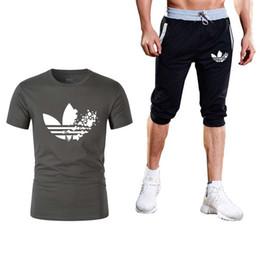 Summer Sportswear Suit Australia - Men's Suit Brand Sportswear New logo Men's T-shirt + Shorts Leisure Short Sleeve T-shirt Summer Leisure Shorts