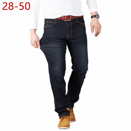 jeans 25 Canada - Big Size 28-50 Man Jeans High Stretch Straight Long Loose Trousers Fashion Casual Black Blue Denim Male Business Jeanswear Pants CX200701