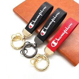 $enCountryForm.capitalKeyWord Australia - Champion Brand Car Keys Ring Braided Silk Drawing Leather Fashion Keychains Various Colours Key Buckle New Arrival 7yyb M1 E1