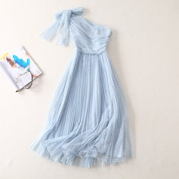 Wholesale European and American women s fashion spring new style Oblique shoulder bow Wave point net yarn Fashion dress