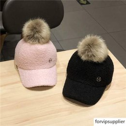 warm baseball cap NZ - 2019 hat women's fashion all-match M-standard fur ball baseball cap thickened warm outdoor winter