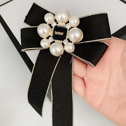 $enCountryForm.capitalKeyWord Australia - 2 Styles Women Pearl Letter C Brooch Suit Lapel Pin Big Bowknot Shirt Pin Accessories for Gift Party High Quality