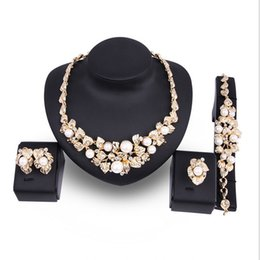 Imitation Pearl Jewelry Sets Australia - Necklace Ring Bracelet Earrings Wedding Jewelry Exquisite Rhinestone Imitation Pearl 18K Gold Plated Leaves 4-Piece Set Jewelry Sets JS500