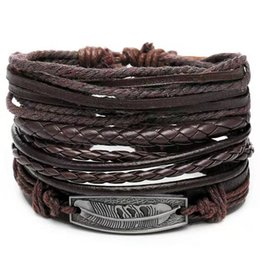 mens handmade leather bracelets NZ - 4pcs set punk leather bracelet jewelry set for men luxury designer mens feather braid rope chain bracelets hip hop handmade casual jewelry