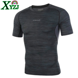 male gym clothes UK - Compression Shirts Men Bodybuilding Run T-shirt Quick Dry Gym Fitness Joggers Crossfit Male Short Skin Tight Tee Tops Clothes