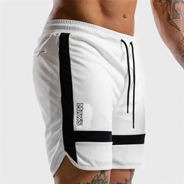 sports bodybuilding Canada - Men Sports Short Pants summer black white casual 2019 Training Bodybuilding Summer Shorts Workout Fitness GYMS Short Pants Y200511