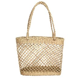 China Hollow Mesh Handmade Straw Bag Casual Woven Handbags Shoulder Beach Bag Unlined Cloth Totes Fashionable Bags For Summer cheap handmade cloth handbags suppliers