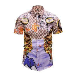 cbae8edc49 Famosa marca de diseño de ropa hombres galaxia dragón de oro estampado de  flores de manga larga camisa 3d impresión barroca Medusa