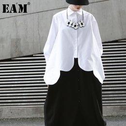 $enCountryForm.capitalKeyWord Australia - [EAM]2019 New Spring Summer Lapel Long Sleeve White Irregular Hem Cut Stitch Irregular Big Size Shirt Women Blouse Fashion JO195 T190611