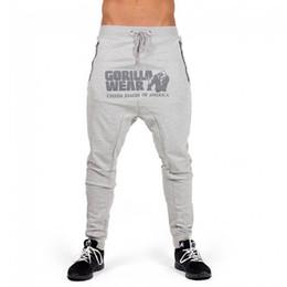 Muscle Print Pants Australia - 2018 New Fashion Brand Men Pants Gorilla Wear Print Solid Muscle Trousers Mens Straight Male Zipper Breathable Workout