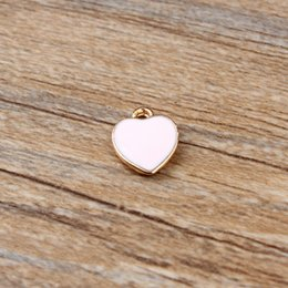 $enCountryForm.capitalKeyWord Australia - 100pcs diy jewelry bead K gold enamel accessories pendant small alloy heart hollow charms free shipping