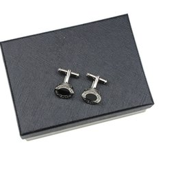 Chinese  High quality fashion stainless steel cufflinks in round design with black for men never change color can use in business fair meeting manufacturers