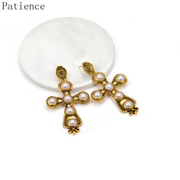 $enCountryForm.capitalKeyWord Australia - Wholesale Cross Hollow Out Earrings Jewelry Vintage Statement Metal Pearl Drop Earrings Dangle Pendientes Bijoux For Women