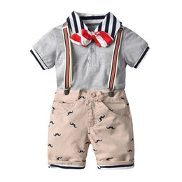 Three Piece Suit Bow Australia - Summer suit new children's short-sleeved casual outing suit bow tie Polo short-sleeved shirt strap shorts four-piece suit