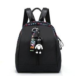 $enCountryForm.capitalKeyWord NZ - 2019 girls solid color Oxford cloth fashion casual zipper ribbon waterproof backpack student bag