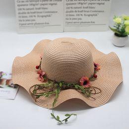 $enCountryForm.capitalKeyWord Australia - High Quality Summer Holiday Straw Hats With Garland UV Protection Hats Girls and Women Beach Straw Sun Hats Outdoor Wavy Straw Caps