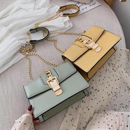 $enCountryForm.capitalKeyWord Australia - outlet brand women handbag foreign style styling leather fashion chain bag gold lock stripe bow women shoulder bag elegant leather bag