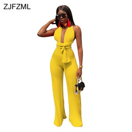 women jumpsuit black blue UK - Zjfzml Sexy Backless Lace Up Bodycon Jumpsuit Women Deep V Neck Sleeveless Party Club Bodysuit 2018 Casual Solid Wide Leg Romper Y19060501