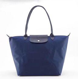 Blue handBag horses online shopping - TOP Quality Thicken Womens designer luxury handbags purses brand Horse Women Cowhide Nylon Handbags Long Handle Lady Folding Bags LE NEO