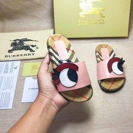 Lo nuevo Calzado Infantil de cuero lindo de dibujos animados ojo impresión zapatillas moda caucho niña suela de verano antideslizante playa deslice la sandalia en venta