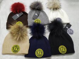 cf46e1b2b03f07 REAL FUR big pom-pom men women beanies F brand winter hats outdoor warm  women beanies black white grey