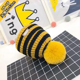 Discount wool ball hat children - New Korean Children Hats Winter Male Girl Wool Cap Hair Ball Outdoors Knitting Hat Stripe Keep Warm Set Head Cap